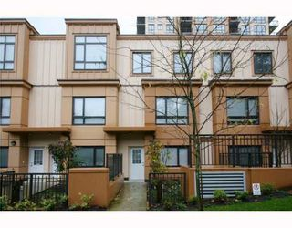 "Photo 1: 402 WESTVIEW Street in Coquitlam: Coquitlam West Townhouse for sale in ""ENCORE"" : MLS®# V800235"