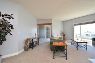 Photo 23: 303 GLENEAGLES View: Cochrane House for sale : MLS®# C4130061
