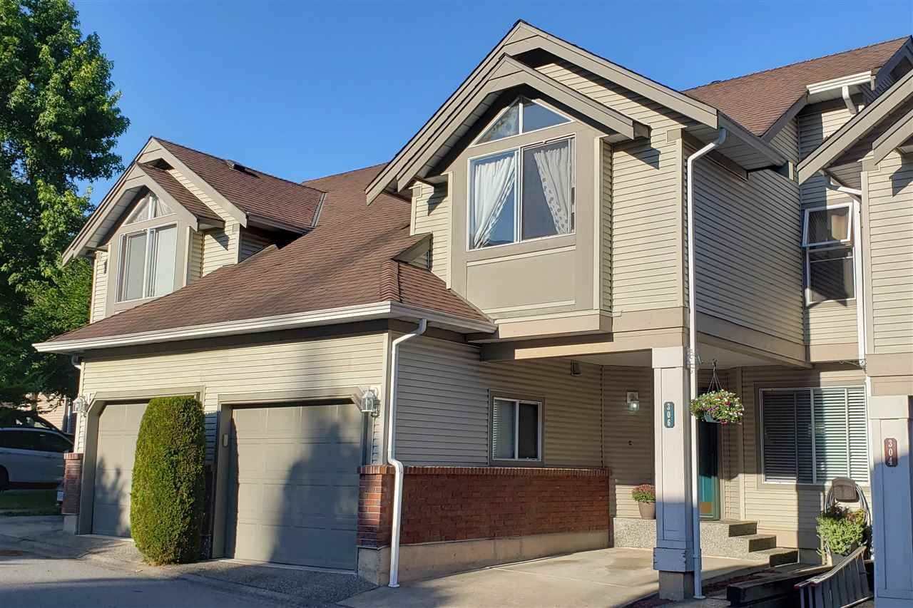"Main Photo: 306 13900 HYLAND Road in Surrey: East Newton Townhouse for sale in ""Hyland Grove"" : MLS®# R2485368"