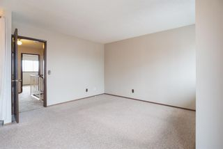 Photo 18: 5 903 67 Avenue SW in Calgary: Kingsland Row/Townhouse for sale : MLS®# A1079413