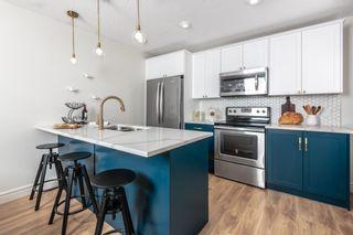 Photo 1: 221 19661 40 Street SE in Calgary: Seton Apartment for sale : MLS®# A1055788