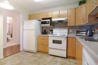 "Photo 8: 406 20239 MICHAUD Crescent in Langley: Langley City Condo for sale in ""City Grande"" : MLS®# R2062935"