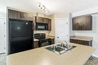 Photo 2: 9103 2781 Chinook Winds Drive SW: Airdrie Row/Townhouse for sale : MLS®# A1102621