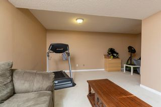Photo 19: 1035 Canfield Crescent SW in Calgary: Canyon Meadows Semi Detached for sale : MLS®# A1087573