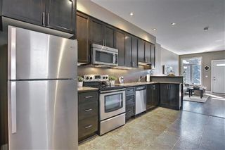 Photo 12: 4514 73 Street NW in Calgary: Bowness Row/Townhouse for sale : MLS®# A1081394
