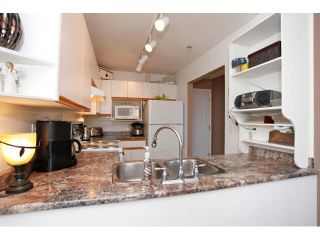 "Photo 7: 311 5955 177B Street in Surrey: Cloverdale BC Condo for sale in ""WINDSOR PLACE"" (Cloverdale)  : MLS®# F1433073"