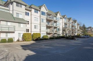 "Photo 1: 402 33688 KING Road in Abbotsford: Poplar Condo for sale in ""College Park"" : MLS®# R2136584"