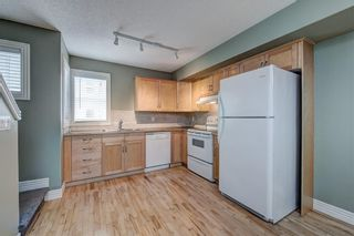 Photo 17: 312 BRIDLEWOOD Lane SW in Calgary: Bridlewood Row/Townhouse for sale : MLS®# A1046866