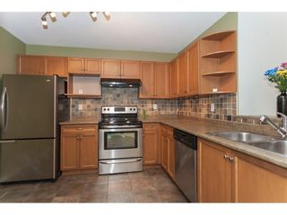 Photo 2: 104 20881 56 Avenue in Langley: Langley City Condo for sale : MLS®# R2564873