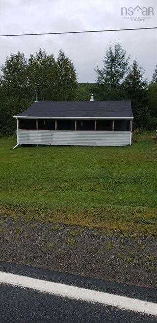 Photo 1: 6948 Cabot Trail Road in North East Margaree: 306-Inverness County / Inverness & Area Residential for sale (Highland Region)  : MLS®# 202123100