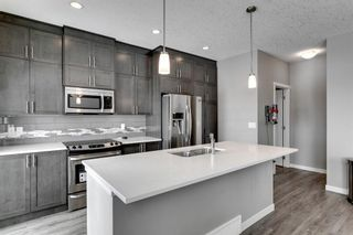 Photo 8: 502 428 Nolan Hill Drive NW in Calgary: Nolan Hill Row/Townhouse for sale : MLS®# A1064360
