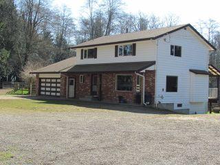 Photo 1: 25170 4 AV in Langley: Otter District House for sale : MLS®# F1441032