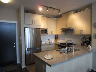 Photo 2: 110 3156 DAYANEE SPRINGS BOULEVARD in Coquitlam: Westwood Plateau Condo for sale : MLS®# R2137060