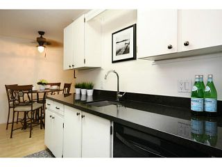 Photo 4: # 108 13507 96TH AV in Surrey: Whalley Condo for sale (North Surrey)  : MLS®# F1417466
