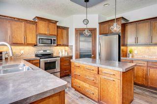 Photo 11: 22 ELGIN ESTATES Grove SE in Calgary: McKenzie Towne Detached for sale : MLS®# A1019563