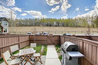 Photo 12: 49 Aspen Hills Drive in Calgary: Aspen Woods Row/Townhouse for sale : MLS®# A1108255