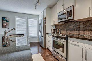 Photo 11: 653 Auburn Bay Boulevard SE in Calgary: Auburn Bay Row/Townhouse for sale : MLS®# A1147022