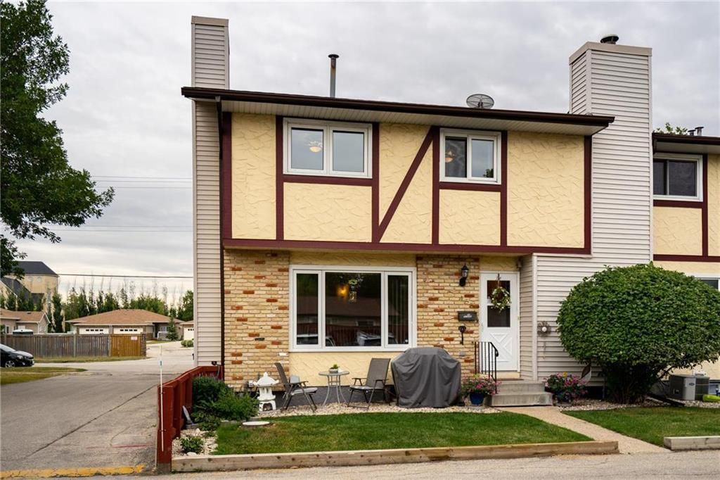 Two story, three bedroom home with a little front yard to watch the world go by.