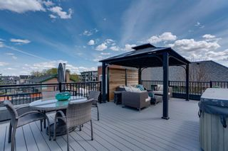 Main Photo: 2 2411 15 Street SW in Calgary: Bankview Row/Townhouse for sale : MLS®# A1106750