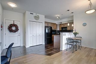 Photo 24: 213 26 VAL GARDENA View SW in Calgary: Springbank Hill Apartment for sale : MLS®# A1095989