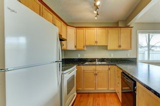 Photo 6: 431 Country Village Cape NE in Calgary: Country Hills Village Row/Townhouse for sale : MLS®# A1043447