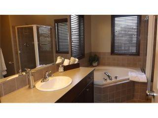 Photo 16: 155 SUNSET Close: Cochrane House for sale : MLS®# C4037159