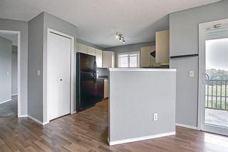 Photo 7: 6413 304 Mackenzie Way SW: Airdrie Apartment for sale : MLS®# A1128019