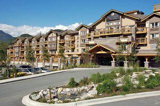 """Photo 1: 210 40900 TANTALUS Road in Squamish: Tantalus Condo for sale in """"Executive Suites Hotel"""" : MLS®# R2442400"""