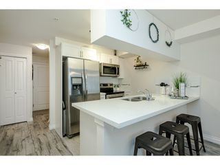 """Photo 14: 306 5650 201A Street in Langley: Langley City Condo for sale in """"Paddington Station"""" : MLS®# R2545910"""