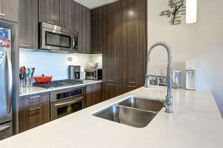 """Photo 9: 604 301 CAPILANO Road in Port Moody: Port Moody Centre Condo for sale in """"RESIDENCES AT SUTER BROOK"""" : MLS®# R2094618"""