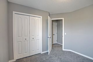 Photo 36: 566 River Heights Crescent: Cochrane Semi Detached for sale : MLS®# A1129968