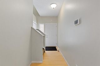Photo 3: 94 Everridge Gardens SW in Calgary: Evergreen Row/Townhouse for sale : MLS®# A1069502