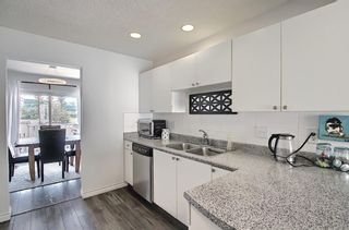 Photo 7: 154 388 Sandarac Drive NW in Calgary: Sandstone Valley Row/Townhouse for sale : MLS®# A1115422
