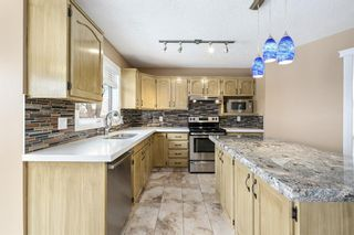 Photo 7: 312 Hawkstone Close NW in Calgary: Hawkwood Detached for sale : MLS®# A1084235