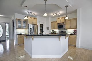 Photo 18: 12 Strathlea Place SW in Calgary: Strathcona Park Detached for sale : MLS®# A1114474