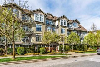 """Photo 1: 406 15323 17A Avenue in Surrey: King George Corridor Condo for sale in """"Semiahmoo Place"""" (South Surrey White Rock)  : MLS®# R2571270"""