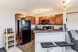 Photo 7: 2411 8 BRIDLECREST Drive SW in Calgary: Bridlewood Apartment for sale : MLS®# A1053319