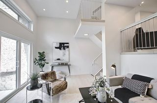 Photo 5: 64 Glamis Gardens SW in Calgary: Glamorgan Row/Townhouse for sale : MLS®# A1112302
