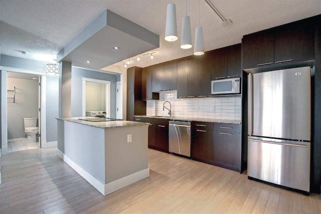 Main Photo: 406 501 57 Avenue SW in Calgary: Windsor Park Apartment for sale : MLS®# A1142596