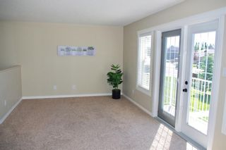 Photo 3: 1 23 Cougar Cove N in Lethbridge: Uplands Residential for sale : MLS®# LD0188989