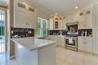 """Photo 14: 7439 146 Street in Surrey: East Newton House for sale in """"Chimney Heights"""" : MLS®# R2602834"""