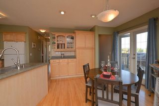 Photo 8: 267 GLENPATRICK Drive: Cochrane House for sale : MLS®# C4139469