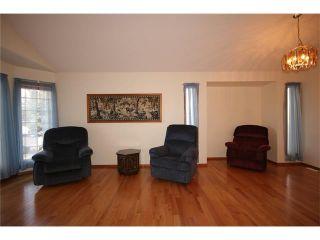 Photo 6: 31 RIVERVIEW Close: Cochrane House for sale : MLS®# C4055630