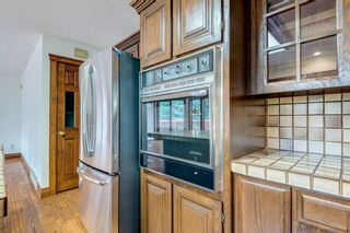 Photo 16: 331 Coach Light Bay SW in Calgary: Coach Hill Detached for sale : MLS®# A1132031