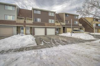 Photo 1: 1309 Ranchlands Road NW in Calgary: Ranchlands Row/Townhouse for sale : MLS®# A1060522