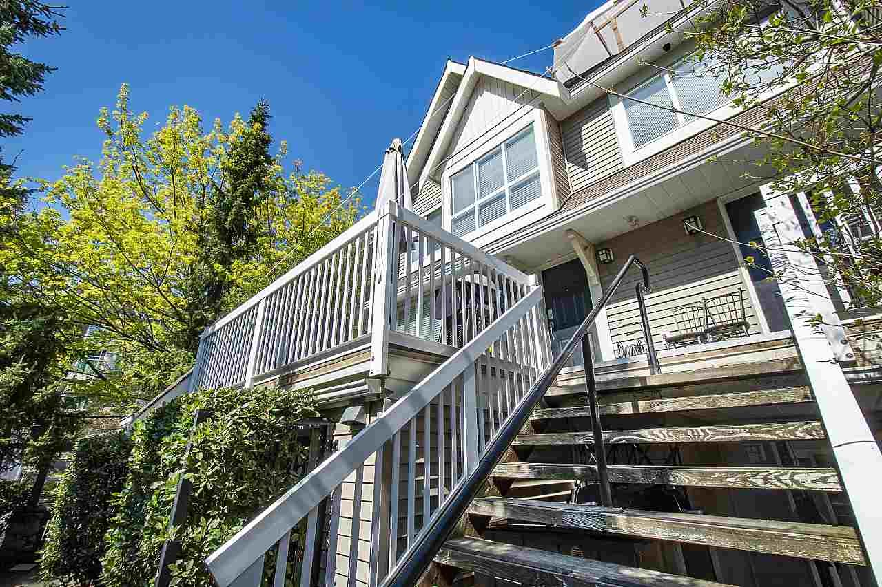 """Main Photo: 4 1071 LYNN VALLEY Road in North Vancouver: Lynn Valley Townhouse for sale in """"River Rock"""" : MLS®# R2584464"""