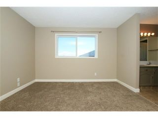Photo 23: 74 WEST TERRACE Road: Cochrane House for sale : MLS®# C4073559