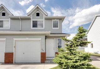 Main Photo: 26 Covemeadow Manor NE in Calgary: Coventry Hills Row/Townhouse for sale : MLS®# A1122991