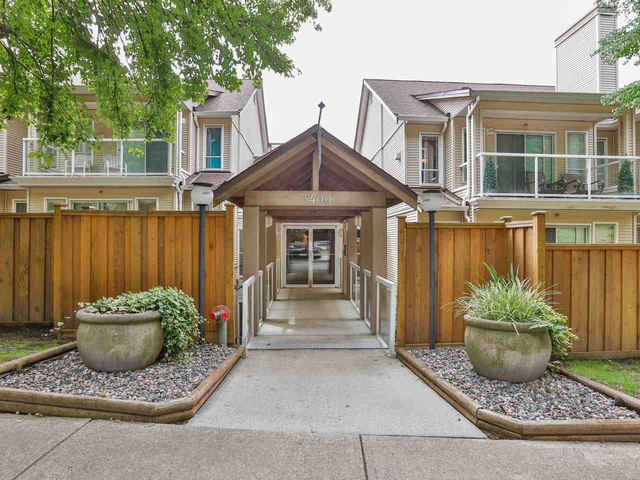 """Main Photo: 215 3400 SE MARINE Drive in Vancouver: Champlain Heights Condo for sale in """"Tiffany Ridge"""" (Vancouver East)  : MLS®# R2392821"""