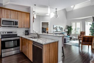 Photo 4: 2408 15 Sunset Square: Cochrane Apartment for sale : MLS®# A1123430